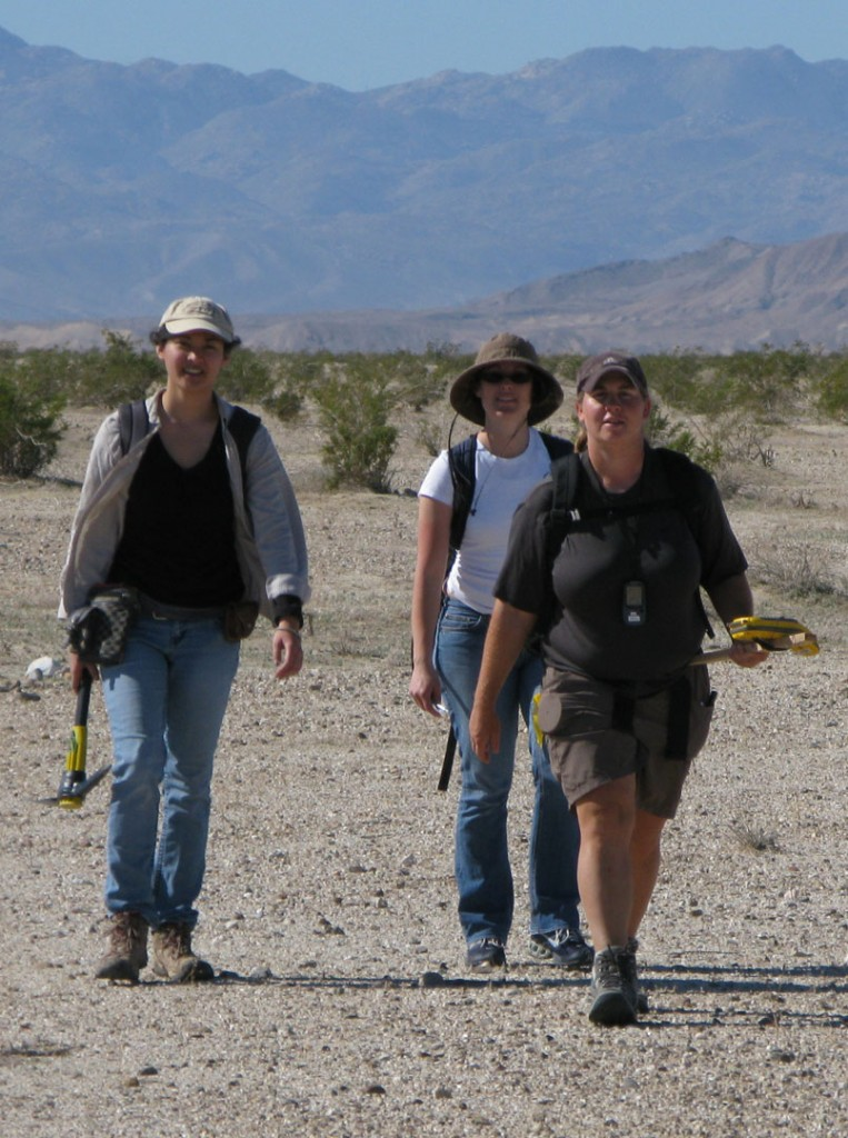 Figure 5. Backpacking seismographs across a Naval bombing range. Each person is carrying about 8 Texan seismographs and deployment equipment.